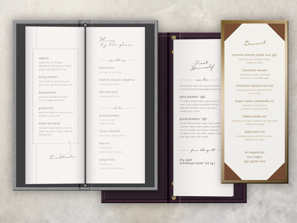 Three art deco style menu covers printed foil stamped